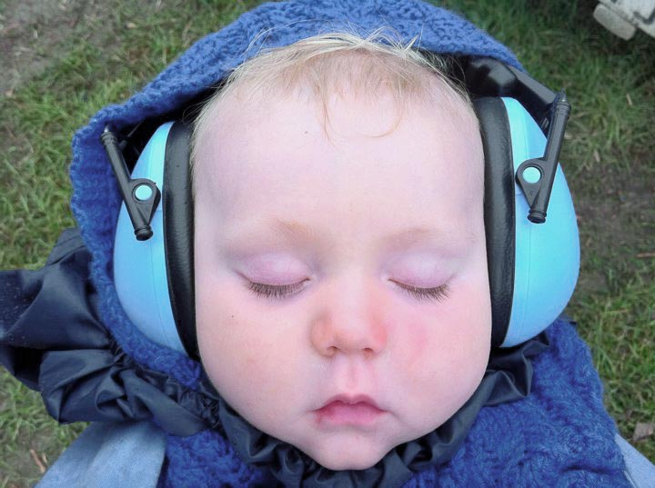 peaceful baby wearing ear defenders